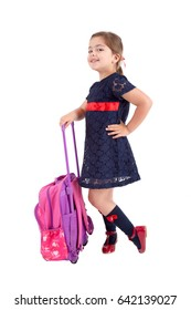small girl with schoolbag isolated over white background