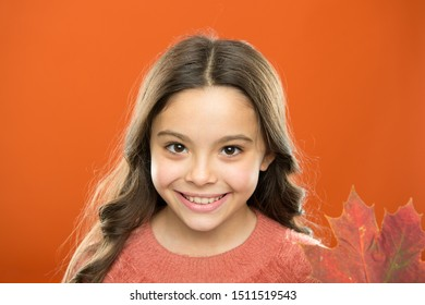 Small girl smile with maple leaf. Maple syrup often used as condiment for pancakes waffles or porridge. Instead of sugar. Ingredient in baking and sweetener. Maple syrup. Little child hold maple leaf.
