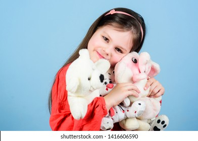 Small girl smiling face with favorite toys. Happy childhood. Little girl play with soft toy teddy bear. Sweet childhood. Collecting toys hobby. Cherishing memories of childhood. Childhood concept.