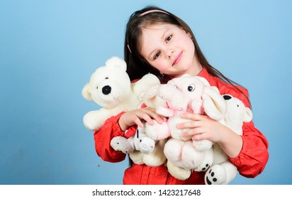 Small girl smiling face with favorite toys. Sweet childhood. Collecting toys hobby. Cherishing memories of childhood. Childhood concept. Happy childhood. Little girl play with soft toy teddy bear.