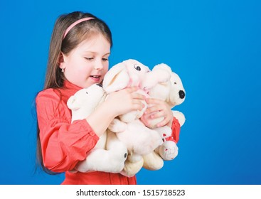 Small girl smiling face with toys. Happy childhood. Little girl play with soft toy teddy bear. Lot of toys in her hands. Collecting toys hobby. Cherishing memories of childhood. Childhood concept.