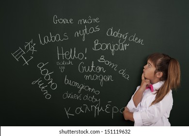 Small girl thinking about foreign phrases