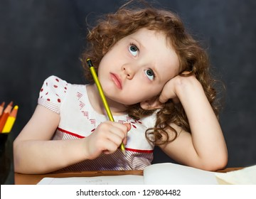 Small girl thought about lessons