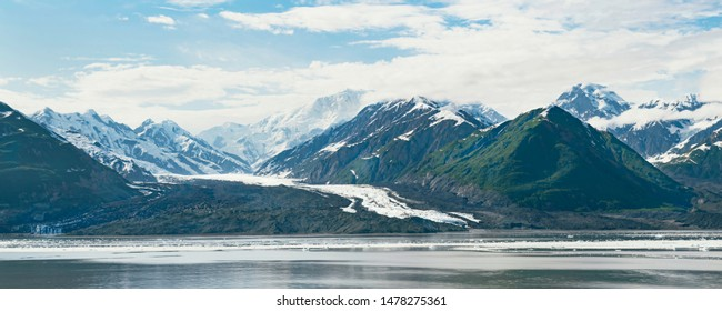 a small glacier on yakutat bay in alaska that appears to be shrinking with the st elias mountains in the background