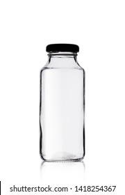 small glass bottle of juice on a white background
