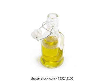 Small glass bottle of olive oil with open lockable lid on a white background