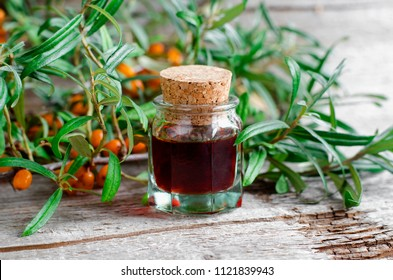 Small glass bottle with sea buckthorn oil (tincture, infusion, extract).