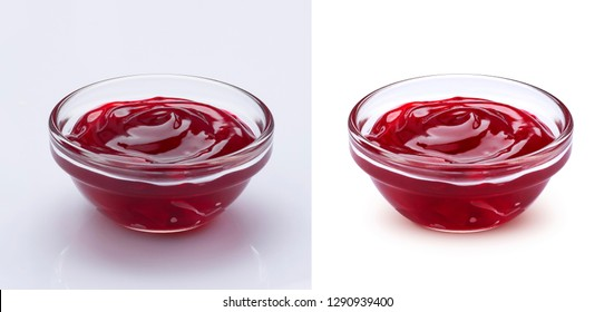 Small glass bowl of red berry jam isolated on white background, sweet cherry jam