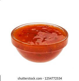 Small glass  bowl of sweet chili sauce isolated .Western cuisine sweet chili sauce made with red chili pepper.Sweet chinese chili sauce