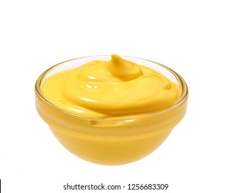 Small glass  bowl of yellow sauce  isolated on white background.Creamy Cheddar sauce