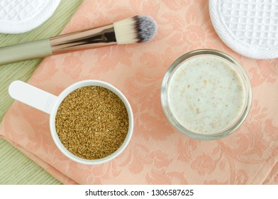 Small glass bowl with yogurt and wheat bran homemade mask/scrub. Natural beauty treatment. Top view, copy space.