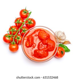Small glass condiment bowl of red tomato sauce ketchup of peree