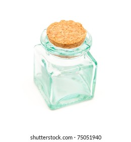 small glass storage  jar stopped with cork, isolated on white background
