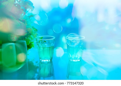 small glass with water on table