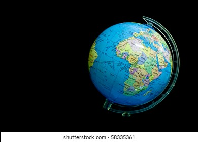 Small globe on black background