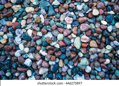 Small glossy color pebbles on the beach