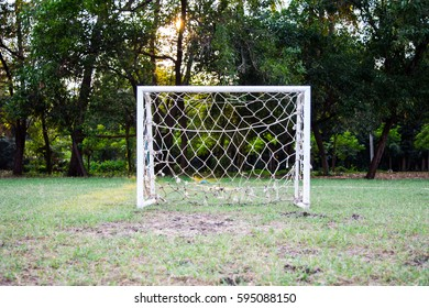 small goal in grass field