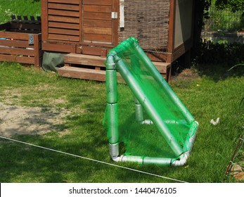 small goalpost with green net in the garden