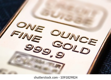 the small  gold bar is one ounce. Pure gold.