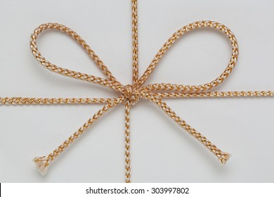 Small Gold String Bow at Gift Wrap