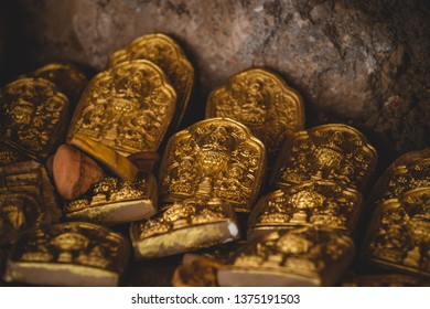 Small golden tokens are left as religious offerings at Drepung Monastery in Lhasa, Tibet.