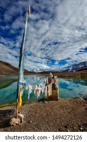 Small gompa with buddhist prayer flags at sacred Dhankar Lake. Spiti Valley, Himachal Pradesh, India