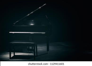 small grand piano in dark room vintage style