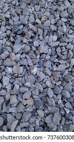 Small gray stone surface on the floor.