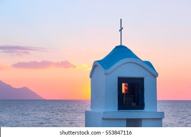 Small greek chapel and mount Athos with sea panorama in Greece