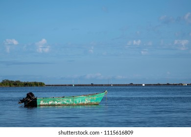 Small Green Boat in the Water, found on Molokai, Hawaii