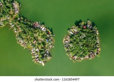 Small green island on a lake