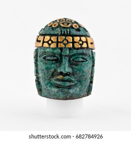 Small green Olmec style souvenir head with clipping path