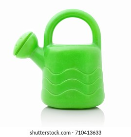 Children´s small green plastic watering can isolated on the white background. Small green plastic can for watering plants and flowers, for playing, for kids. Miniature of watering can for children