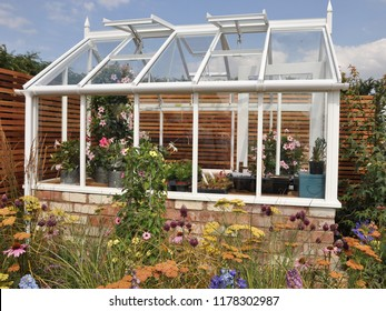 Small greenhouse in flower lovers garden