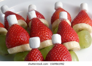 small grinches very healthy at Christmas time for eating and decorating from grapes banana strawberry and marshmallows close up