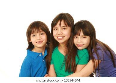 small group of asian children hugging with copy space