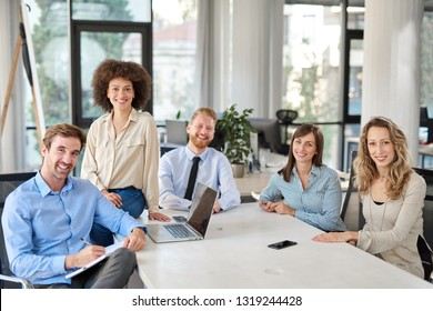 Small group of business people posing in office. Start up business concept. Multi ethnic group.