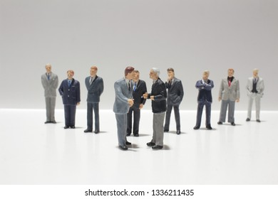 a small group figures of business meeting