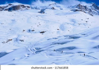 A small group of skiers ascends to the Monte Rosa Hut near Zermatt, Switzerland