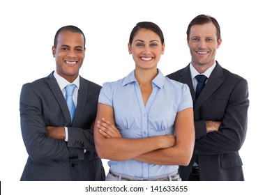 Small group of smiling business people standing together on white background