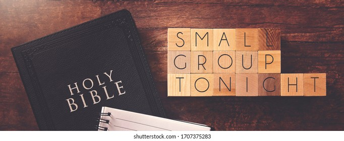 Small Group Tonight in Block Letters on a Wooden Table with a Bible