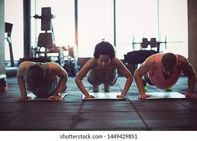Small group training. People at gym.
