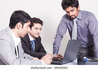 small group of young businessmen in office meeting