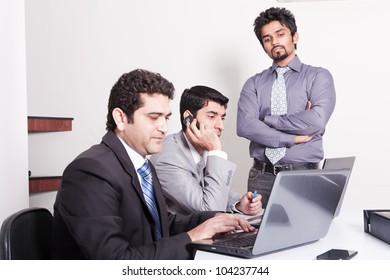 small group of young multiracial businessmen in office meeting