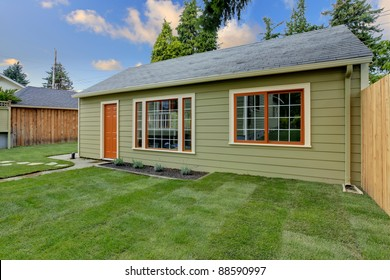 Small guest house in the fenced backyard.