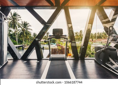 Small gym in Luxury villa, big window, tropical view with palm trees skyline