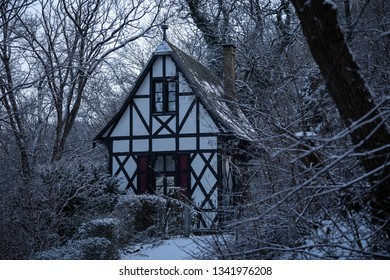 Small half-timbered house in the snowy forest