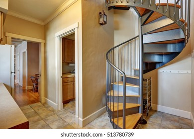 Small hallway interior with spiral metal staircase. Northwest, USA
