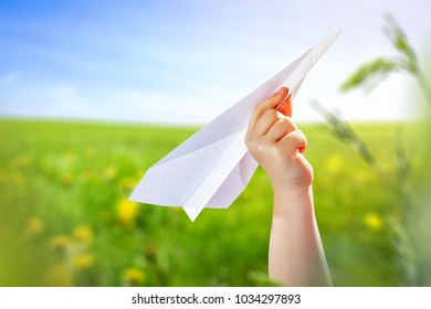 small hand and paper airplane