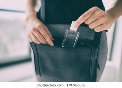 Small hand sanitizer bottle to go in woman's purse. Girl using portable sanitizer in bag, when going on commute, for disinfecting hands as Covid 19 prevention.